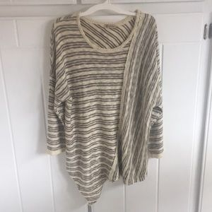 Democracy cream and brown sweater